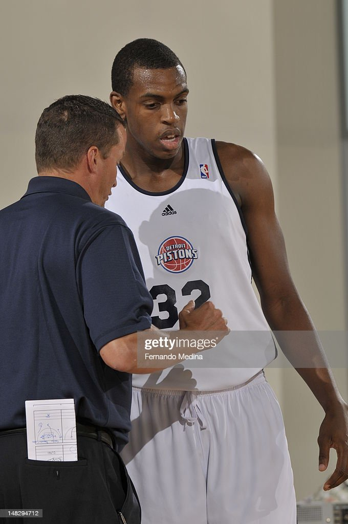 Khris Middleton and John Loyer of the Detroit Pistons talk against the Philadelphia 76ers during the 2012 Air Tran Airways Orlando Pro Summer League on July 13, 2012 at Amway Center in Orlando, Florida.