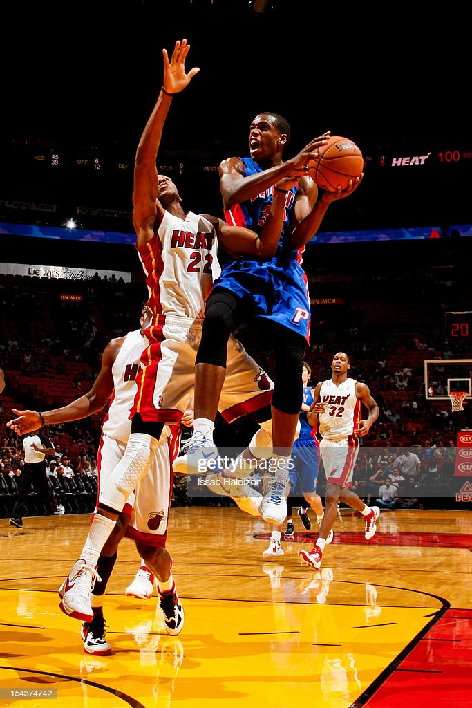 Khris Middleton #32 of the Detroit Pistons attempts a shot against James Jones #22 of the Miami Heat during a pre-season game on October 18, 2012 at American Airlines Arena in Miami, Florida.