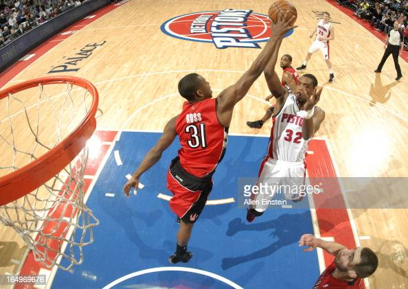 Khris Middleton of the Detroit Pistons goes to the basket as Terrence Ross of the Toronto Raptors defends during the game between the Detroit Pistons...