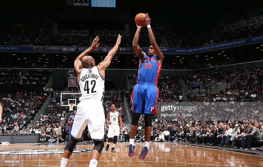 Khris Middleton #32 of the Detroit Pistons shoots against Jerry Stackhouse #42 of the Brooklyn Nets on April 17, 2013 at the Barclays Center in the Brooklyn borough of New York City.