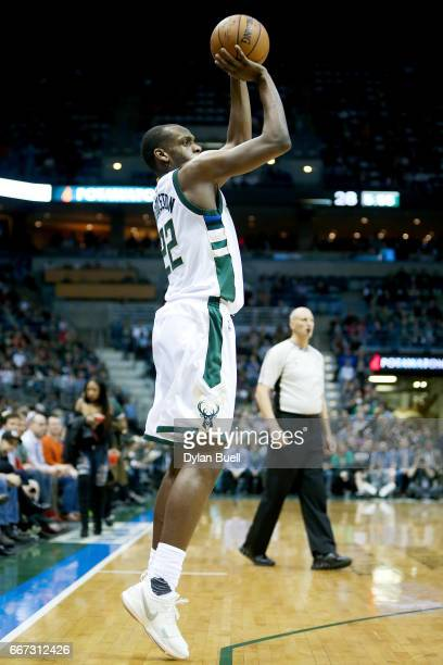 Khris Middleton of the Milwaukee Bucks attempts a shot in the second quarter against the Charlotte Hornets at BMO Harris Bradley Center on April 10...