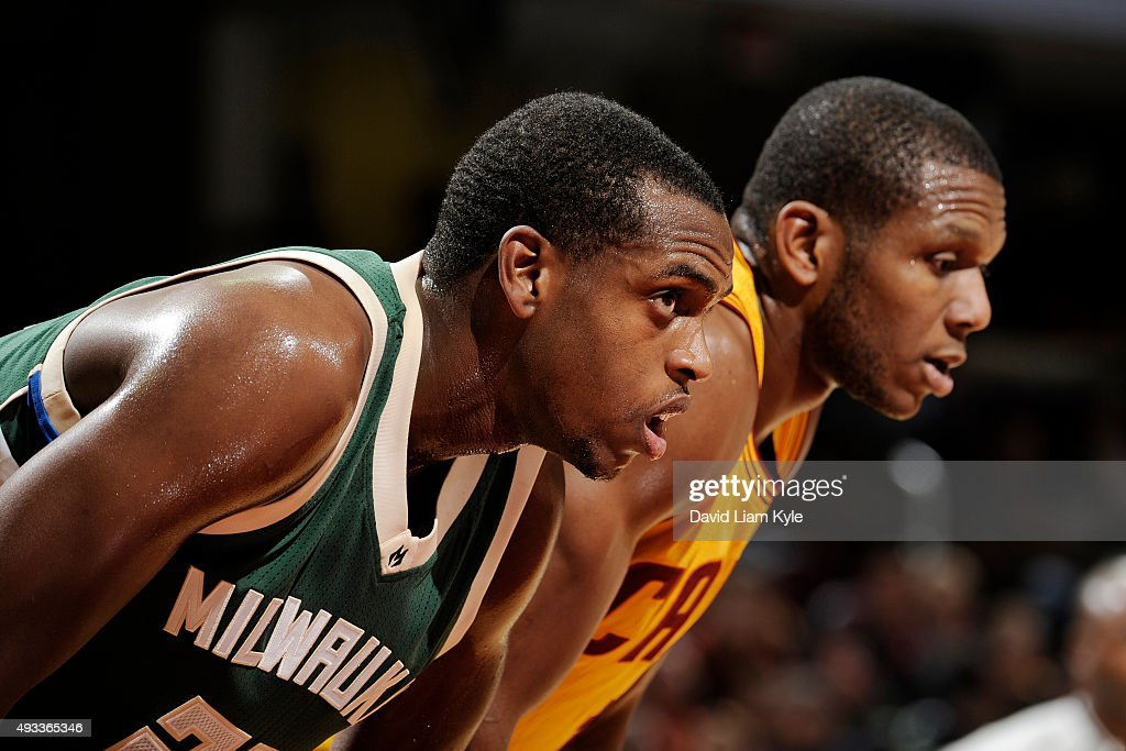 Khris Middleton of the Milwaukee Bucks boxes out against James Jones of the Cleveland Cavaliers on October 13 2015 at Quicken Loans Arena in...