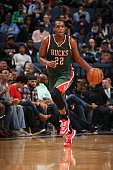 Khris Middleton of the Milwaukee Bucks brings the ball up court against the Memphis Grizzlies on March 14 2015 at FedExForum in Memphis Tennessee...