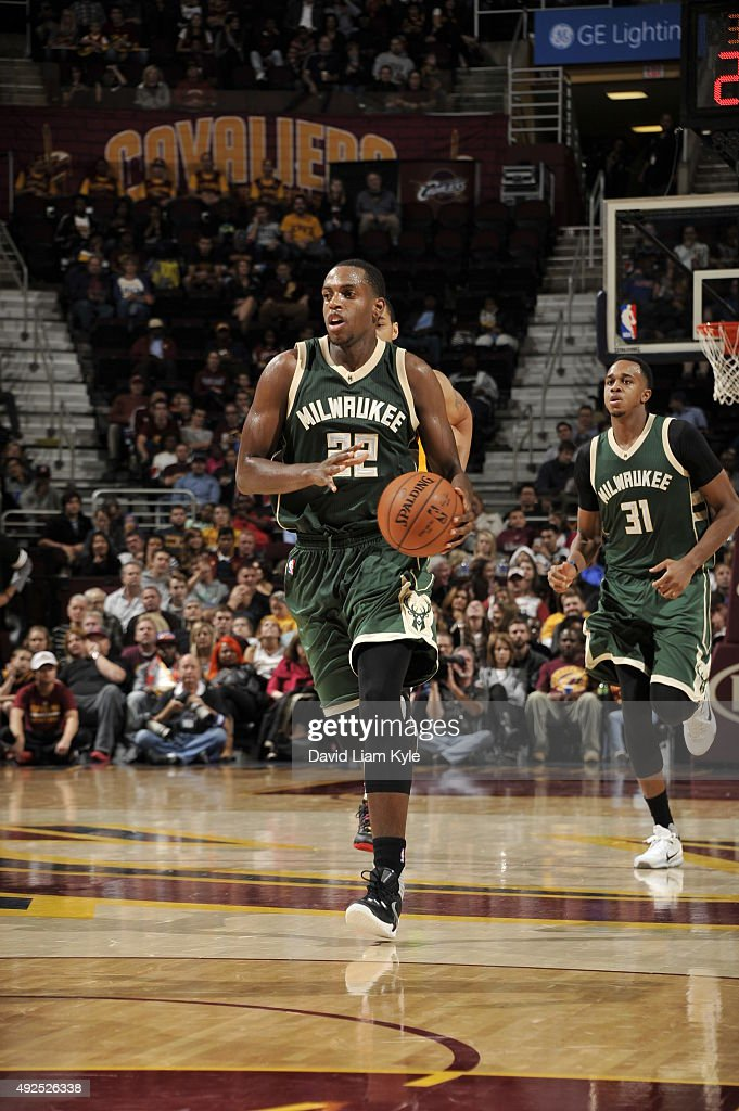 Khris Middleton of the Milwaukee Bucks brings the ball up court against the Cleveland Cavaliers on October 13 2015 at Quicken Loans Arena in...