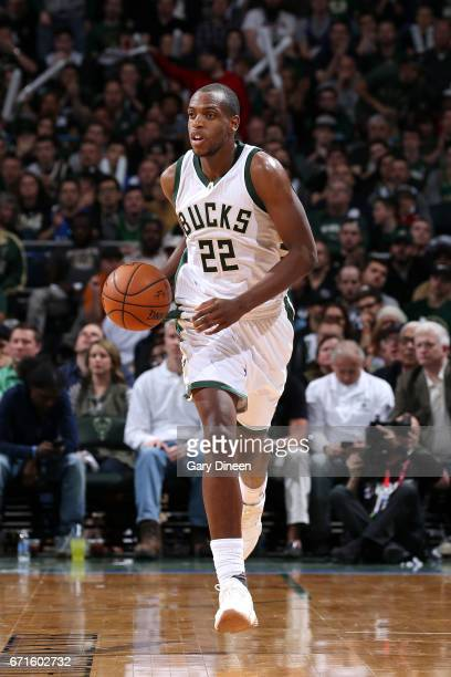 Khris Middleton of the Milwaukee Bucks brings the ball up court during the game against the Toronto Raptors in Game Four during the Eastern...