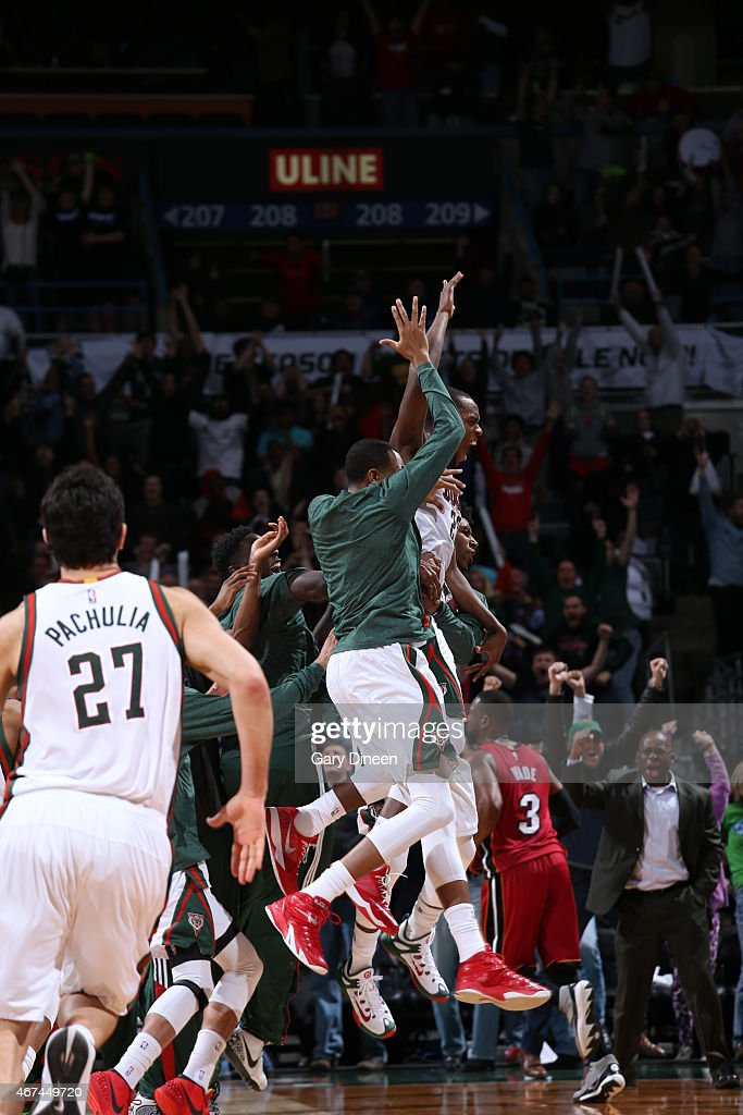 Khris Middleton of the Milwaukee Bucks celebrate after winning the game against the Miami Heat on March 24 2015 at BMO Harris Bradley Center in...