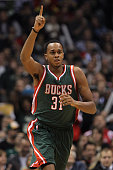 Khris Middleton of the Milwaukee Bucks celebrates after scoring two pints during the first half against the Philadelphia 76ers against the Milwaukee...
