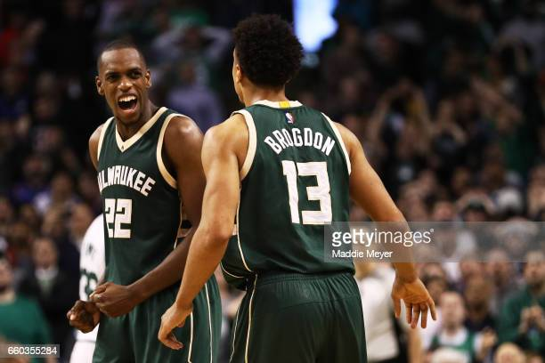 Khris Middleton of the Milwaukee Bucks celebrates with Malcolm Brogdon during the fourth quarter against the Boston Celtics at TD Garden on March 29...