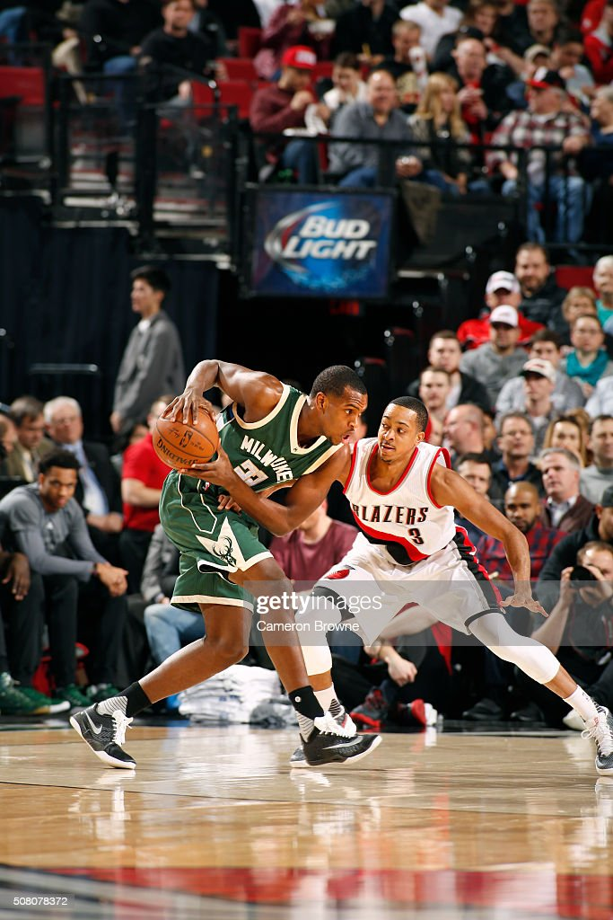 Khris Middleton of the Milwaukee Bucks defends the ball against the Portland Trail Blazers during the game on February 2 2016 at Moda Center in...
