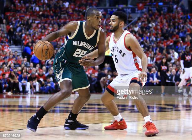 Khris Middleton of the Milwaukee Bucks dribbles the ball as Cory Joseph of the Toronto Raptors defends in the first half of Game Two of the Eastern...