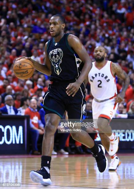 Khris Middleton of the Milwaukee Bucks dribbles the ball in the second half of Game Five of the Eastern Conference Quarterfinals against the Toronto...