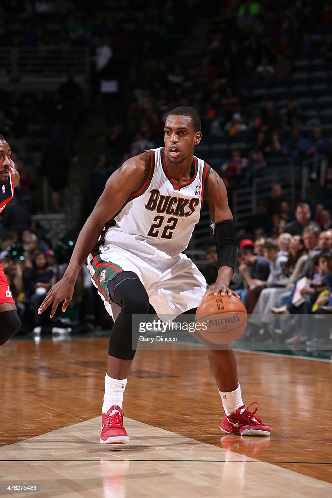 <a gi-track='captionPersonalityLinkClicked' href=/galleries/search?phrase=Khris+Middleton&family=editorial&specificpeople=6689629 ng-click='$event.stopPropagation()'>Khris Middleton</a> #22 of the Milwaukee Bucks drives against the Washington Wizards on March 8, 2014 at the BMO Harris Bradley Center in Milwaukee, Wisconsin.
