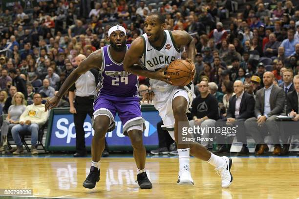Khris Middleton of the Milwaukee Bucks drives around Buddy Hield of the Sacramento Kings during a game at the Bradley Center on December 2 2017 in...