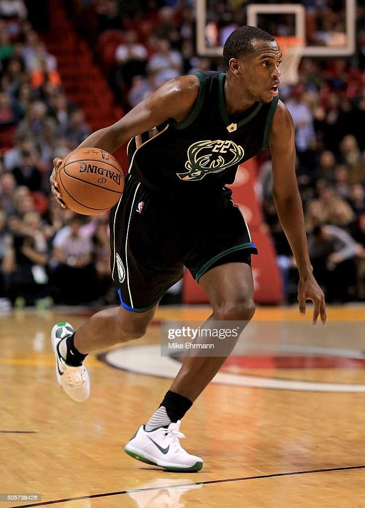 Khris Middleton of the Milwaukee Bucks drives during a game against the Miami Heat at American Airlines Arena on January 19 2016 in Miami Florida...