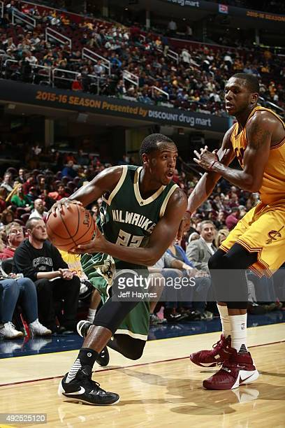 Khris Middleton of the Milwaukee Bucks drives to the basket against the Cleveland Cavaliers on October 13 2015 at Quicken Loans Arena in Cleveland...