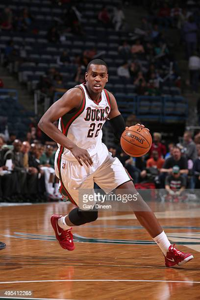 Khris Middleton of the Milwaukee Bucks drives to the basket against the Cleveland Cavaliers on April 11 2014 at the BMO Harris Bradley Center in...