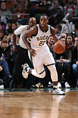 Khris Middleton of the Milwaukee Bucks drives to the basket against the Brooklyn Nets on November 7 2015 at the BMO Harris Bradley Center in...