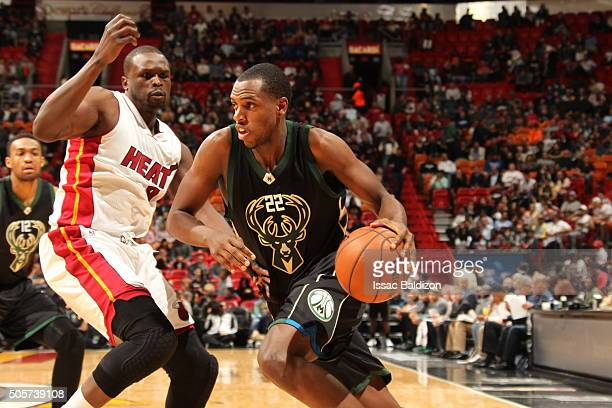 Khris Middleton of the Milwaukee Bucks drives to the basket against the Miami Heat on January 19 2016 at AmericanAirlines Arena in Miami Florida NOTE...