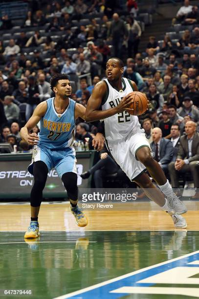 Khris Middleton of the Milwaukee Bucks drives to the basket against Jamal Murray of the Denver Nuggets during a game at the BMO Harris Bradley Center...