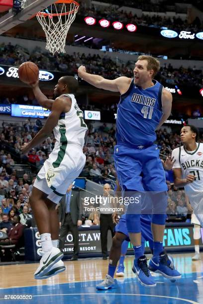 Khris Middleton of the Milwaukee Bucks drives to the basket against Dirk Nowitzki of the Dallas Mavericks in the secodn half at American Airlines...