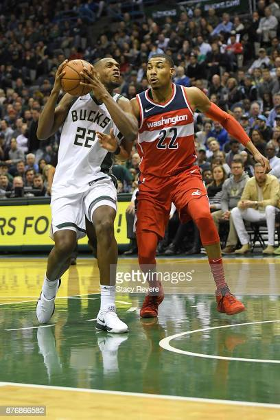 Khris Middleton of the Milwaukee Bucks drives to the basket against Otto Porter Jr #22 of the Washington Wizards during the first half of a game at...