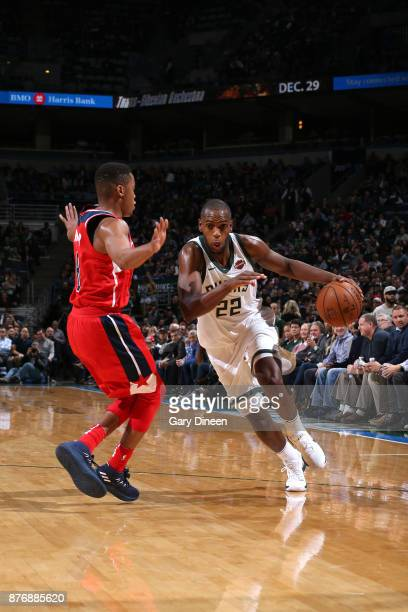 Khris Middleton of the Milwaukee Bucks drives to the basket against the Washington Wizards on November 20 2017 at the BMO Harris Bradley Center in...