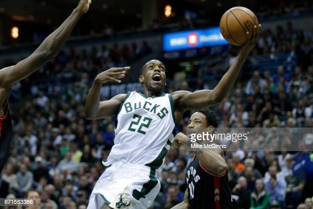 Khris Middleton of the Milwaukee Bucks drives to the hoop during the first half against the Toronto Raptors of Game Four of the Eastern Conference...
