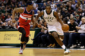 Khris Middleton of the Milwaukee Bucks drives to the hoop for two points during the first quarter against the Washington Wizards at BMO Harris...