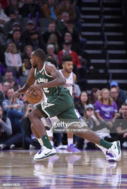 Khris Middleton of the Milwaukee Bucks drives towards the basket against the Sacramento Kings during their NBA basketball game at Golden 1 Center on...