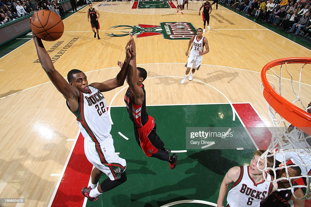 <a gi-track='captionPersonalityLinkClicked' href=/galleries/search?phrase=Khris+Middleton&family=editorial&specificpeople=6689629 ng-click='$event.stopPropagation()'>Khris Middleton</a> #22 of the Milwaukee Bucks dunks against DeMar DeRozan #10 of the Toronto Raptors on November 2, 2013 at the BMO Harris Bradley Center in Milwaukee, Wisconsin.