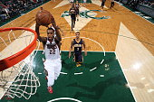 Khris Middleton of the Milwaukee Bucks dunks against the Indiana Pacers on March 26 2015 at BMO Harris Bradley Center in Milwaukee Wisconsin NOTE TO...
