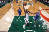 Khris Middleton of the Milwaukee Bucks dunks against the Los Angeles Clippers on January 27 2014 at the BMO Harris Bradley Center in Milwaukee...