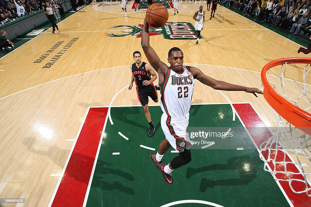 <a gi-track='captionPersonalityLinkClicked' href=/galleries/search?phrase=Khris+Middleton&family=editorial&specificpeople=6689629 ng-click='$event.stopPropagation()'>Khris Middleton</a> #22 of the Milwaukee Bucks dunks against the Toronto Raptors on November 2, 2013 at the BMO Harris Bradley Center in Milwaukee, Wisconsin.