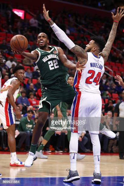 Khris Middleton of the Milwaukee Bucks gets a shot off around Eric Moreland of the Detroit Pistons during the first half at Little Caesars Arena on...