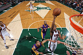 Khris Middleton of the Milwaukee Bucks goes for the layup against the Los Angeles Lakers during the game on February 4 2015 at BMO Harris Bradley...