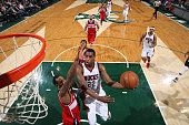Khris Middleton of the Milwaukee Bucks goes for the layup against the Washington Wizards during the game on March 7 2015 at BMO Harris Bradley Center...