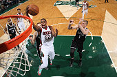 Khris Middleton of the Milwaukee Bucks goes for the layup against the Brooklyn Nets during the game on April 12 2015 at BMO Harris Bradley Center in...