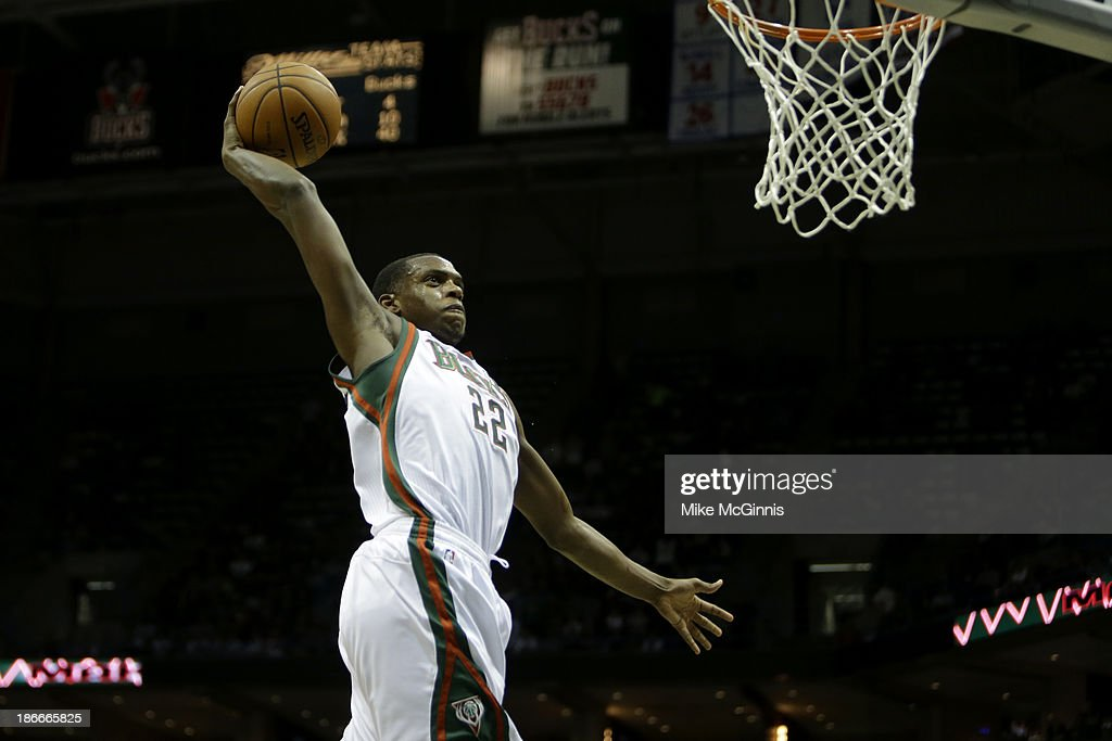 <a gi-track='captionPersonalityLinkClicked' href=/galleries/search?phrase=Khris+Middleton&family=editorial&specificpeople=6689629 ng-click='$event.stopPropagation()'>Khris Middleton</a> #22 of the Milwaukee Bucks goes in for the one handed jam during the second half of play against the Toronto Raptors at Bradley Center on November 2, 2013 in Milwaukee, Wisconsin.
