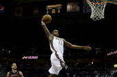 Khris Middleton of the Milwaukee Bucks goes in for the one handed jam during the second half of play against the Toronto Raptors at Bradley Center on...