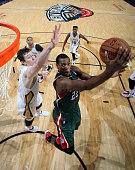 Khris Middleton of the Milwaukee Bucks goes to the basket against the New Orleans Pelicans on March 17 2015 at the Smoothie King Center in New...