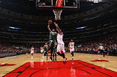 Khris Middleton of the Milwaukee Bucks goes to the basket against the Chicago Bulls during a preseason game on October 6 2015 at the United Center in...