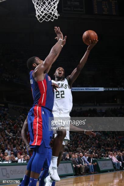 Khris Middleton of the Milwaukee Bucks goes to the basket against the Detroit Pistons on November 15 2017 at the BMO Harris Bradley Center in...