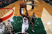 Khris Middleton of the Milwaukee Bucks goes up for a dunk against the Brooklyn Nets on February 9 2015 at BMO Harris Bradley Center in Milwaukee...