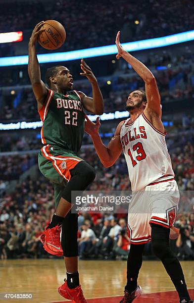 Khris Middleton of the Milwaukee Bucks goes up for a shot against Joakim Noah of the Chicago Bulls during the first round of the 2015 NBA Playoffs at...