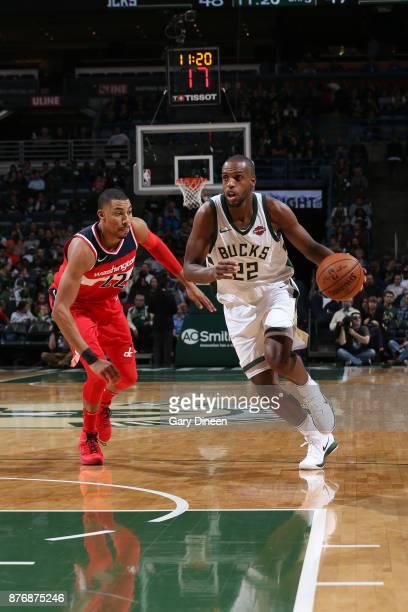 Khris Middleton of the Milwaukee Bucks handles the ball against Otto Porter Jr #22 of the Washington Wizards on November 20 2017 at the BMO Harris...