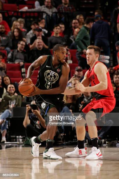Khris Middleton of the Milwaukee Bucks handles the ball against Pat Connaughton of the Portland Trail Blazers on November 30 2017 at the Moda Center...