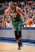 Khris Middleton of the Milwaukee Bucks handles the ball against the Dallas Mavericks on December 7 2014 at the American Airlines Center in Dallas...