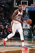 Khris Middleton of the Milwaukee Bucks handles the ball against the Miami Heat on March 24 2015 at BMO Harris Bradley Center in Milwaukee Wisconsin...