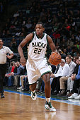 Khris Middleton of the Milwaukee Bucks handles the ball against the Washington Wizards on February 11 2016 at the BMO Harris Bradley Center in...
