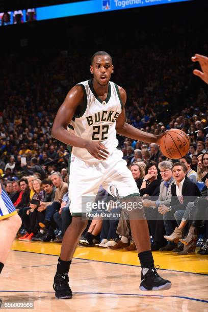 Khris Middleton of the Milwaukee Bucks handles the ball against the Golden State Warriors on March 18 2017 at ORACLE Arena in Oakland California NOTE...
